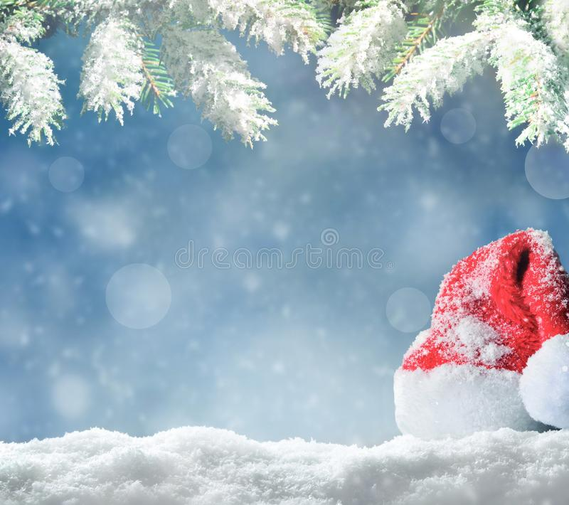 Christmas background. Winter park and sky as background. Christmas background. Winter snowy park, santa hat and sky as background royalty free stock photo