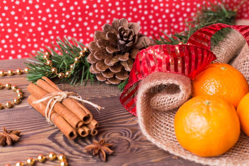 Christmas background - vintage wood, cinnamon, star anise, sweet mandarins, a New Year`s decor.Top view, blank space royalty free stock photo