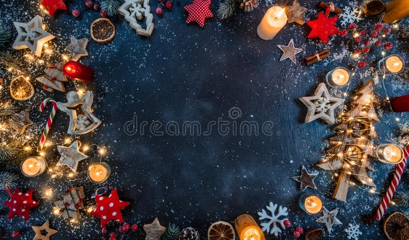 Christmas background with wooden decorations and candles. Free s royalty free stock images