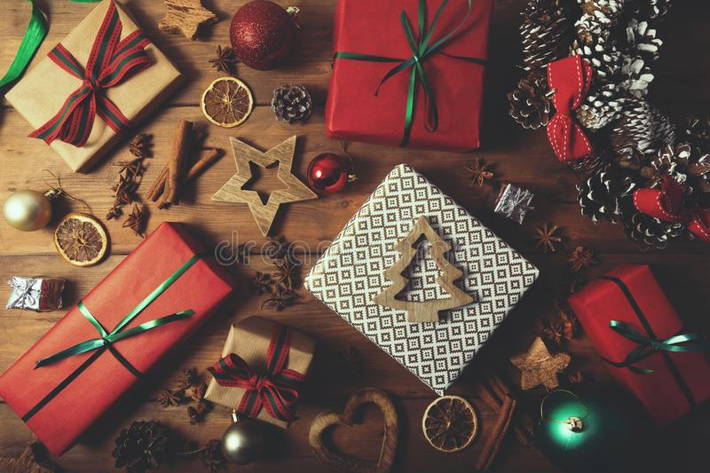 Christmas background - wrapped gifts and decorations on wooden table. Top view royalty free stock photography