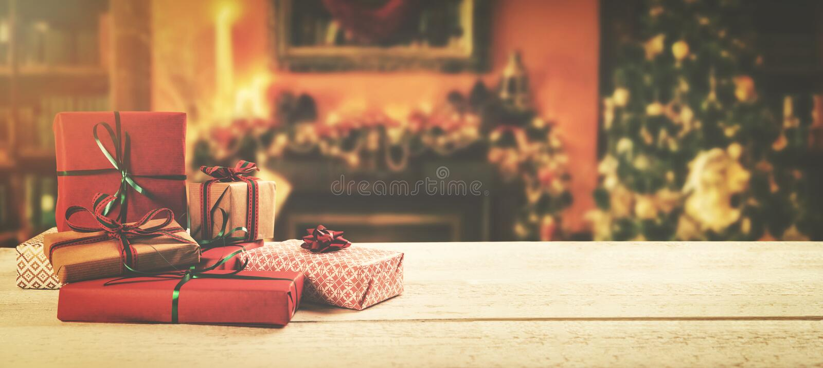 christmas background - wrapped gifts on the table in the room stock photography