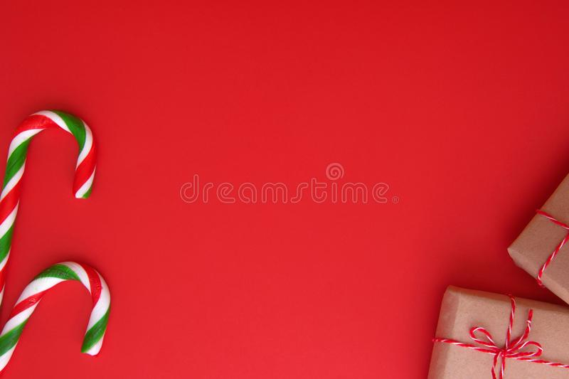Christmas background with Xmas gifts and candy canes. Top view, flat lay. Copy space for text. Winter holidays concept stock photography