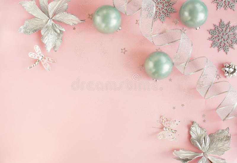 Christmas background . Xmas or new year white silver color decorations on pastel pink background stock photos
