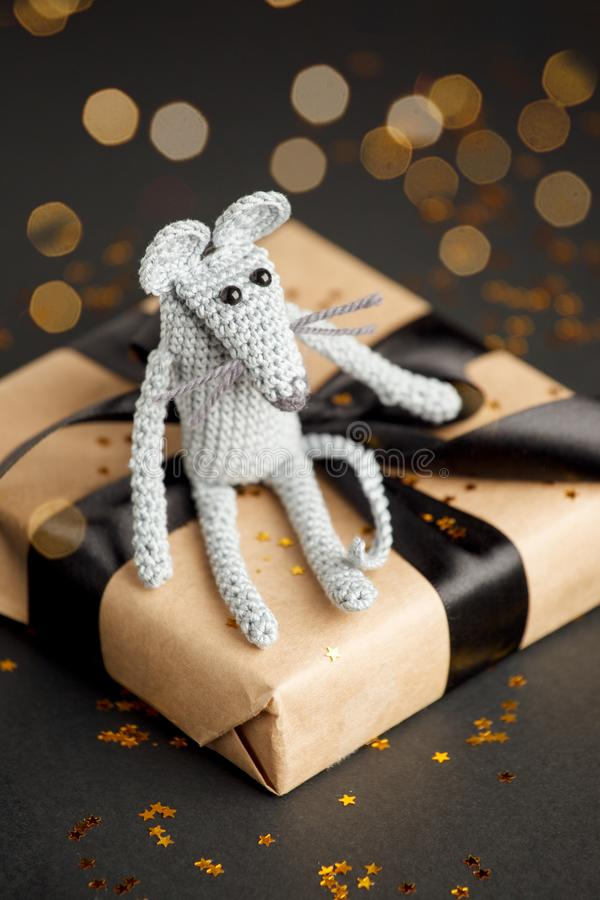 Christmas background. Xmas rat, mouse toy, symbol chinese happy new year 2020. Close up mouse toy and new year gift box. horoscope. Sign 2020. Copy space stock photos