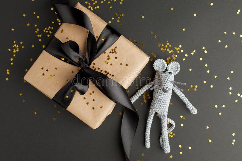 Christmas background. Xmas rat, mouse toy, symbol chinese happy new year 2020. Close up mouse toy and new year gift box. horoscope. Sign 2020. Copy space stock image