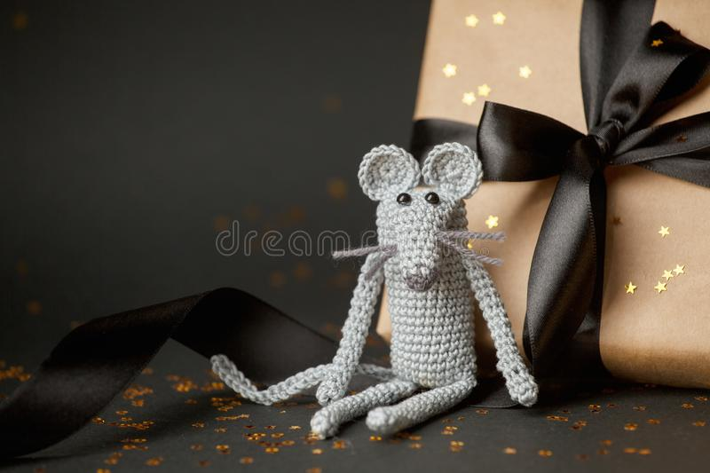 Christmas background. Xmas rat, mouse toy, symbol chinese happy new year 2020. Close up mouse toy and new year gift box. horoscope. Sign 2020. Copy space royalty free stock image