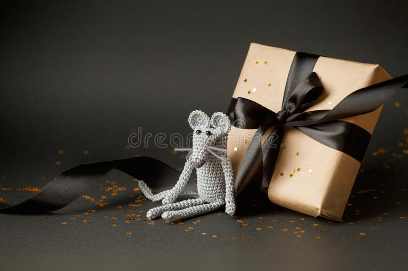 Christmas background. Xmas rat, mouse toy, symbol chinese happy new year 2020. Close up mouse toy and new year gift box. horoscope. Sign 2020. Copy space royalty free stock images