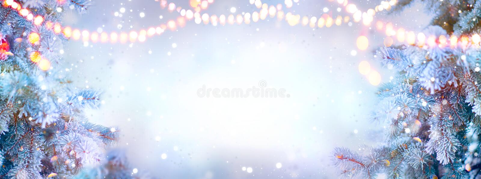 Christmas background. Xmas tree with snow decorated with garland lights, holiday festive backdround. Widescreen frame backdrop. New year Winter art design royalty free stock images