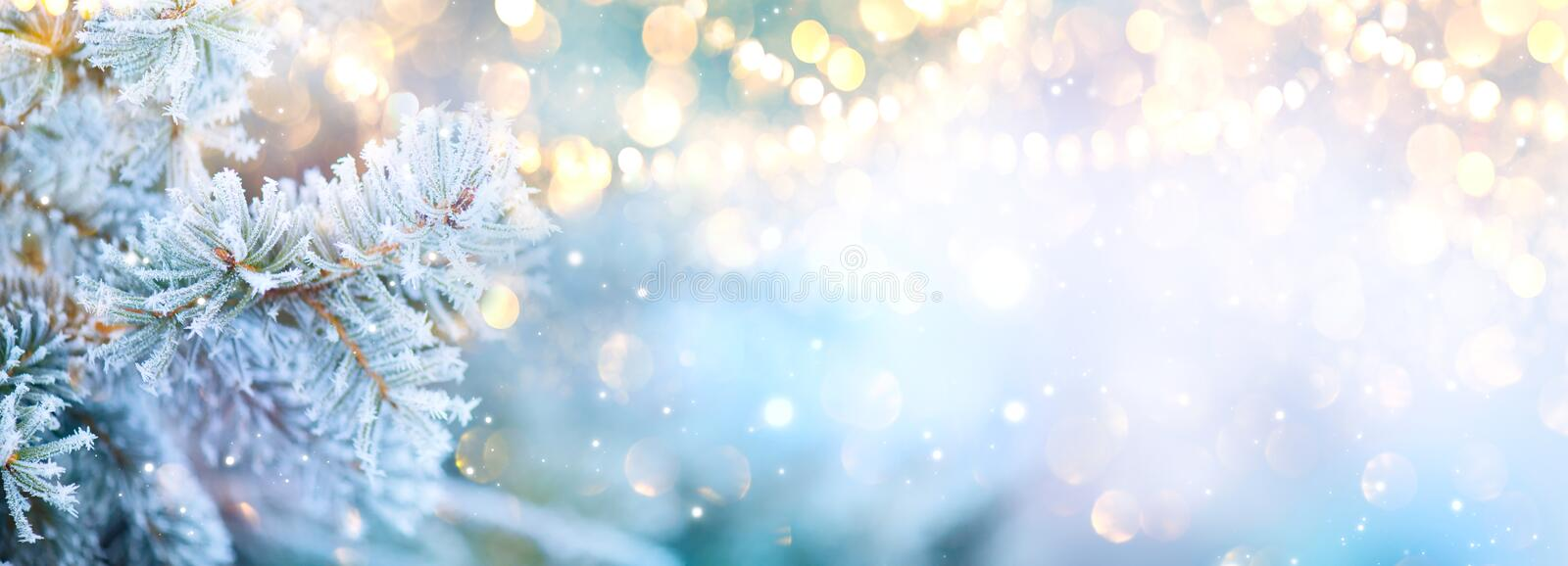 Christmas background. Xmas tree with snow decorated with garland lights, holiday festive background. Widescreen frame backdrop. New year Winter art design royalty free stock photo