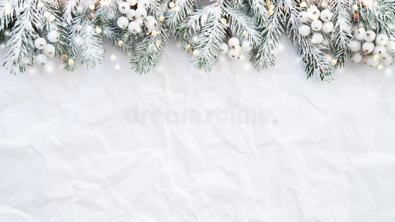 Christmas background with xmas tree on white creased background. Merry christmas greeting card, frame, banner. Winter holiday theme. Happy New Year. Space for stock photos