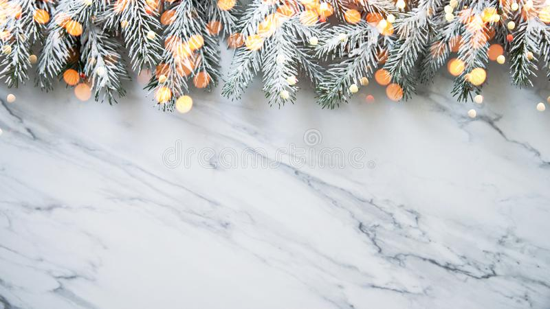 Christmas background with xmas tree on white marble background. Merry christmas greeting card, frame, banner. Winter holiday theme royalty free stock photos