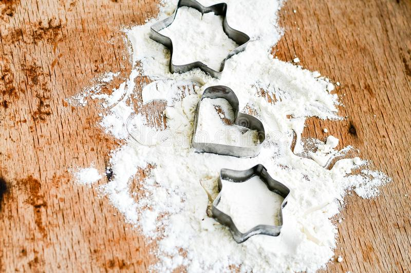 Christmas baking background with flour, cookie cutter royalty free stock image