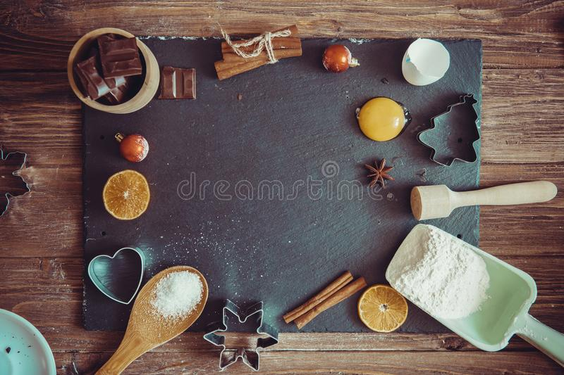 Christmas Baking background. Ingredients for cooking christmas baking on dark shale rusty background stock photography