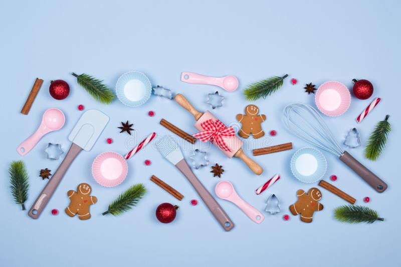 Ingredients for cooking christmas cookies, kitchen utensils, gingerbread cookies on blue pastel background. stock photos