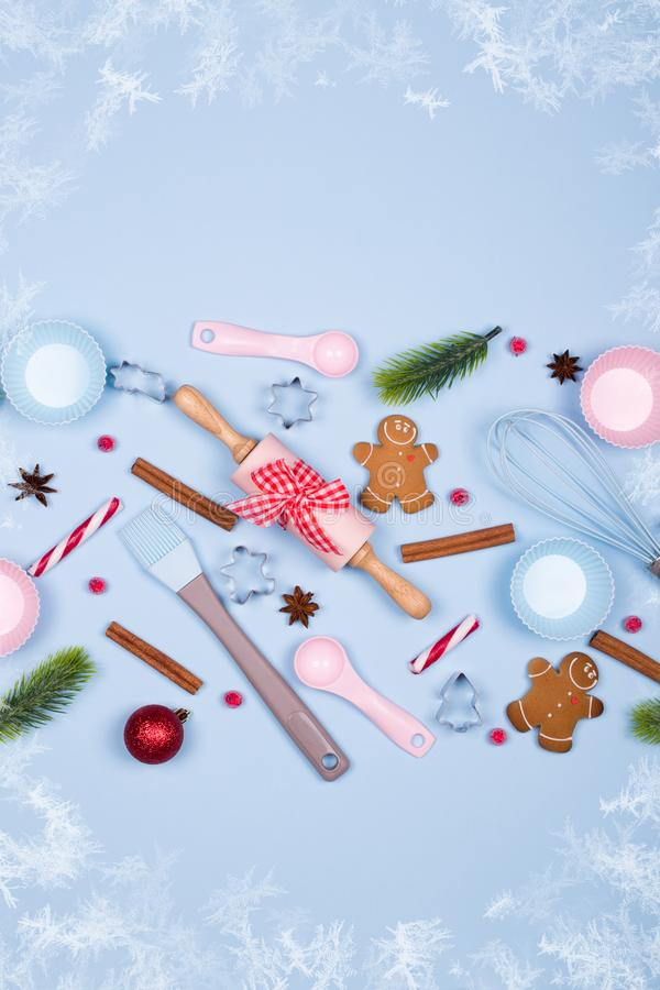 Christmas Baking background. Ingredients for cooking christmas cookies, kitchen utensils, gingerbread cookies stock photo