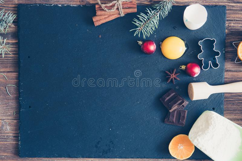 Christmas Baking background. Ingredients for cooking christmas baking on dark stone background. Top view with copy space royalty free stock images