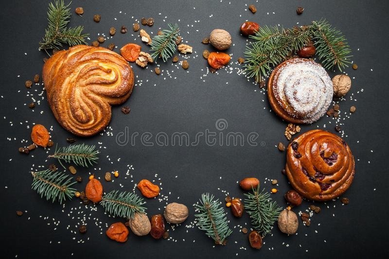 Christmas baking background. Sweet buns with nuts and dried fruits. Top view with a copy space.  royalty free stock image