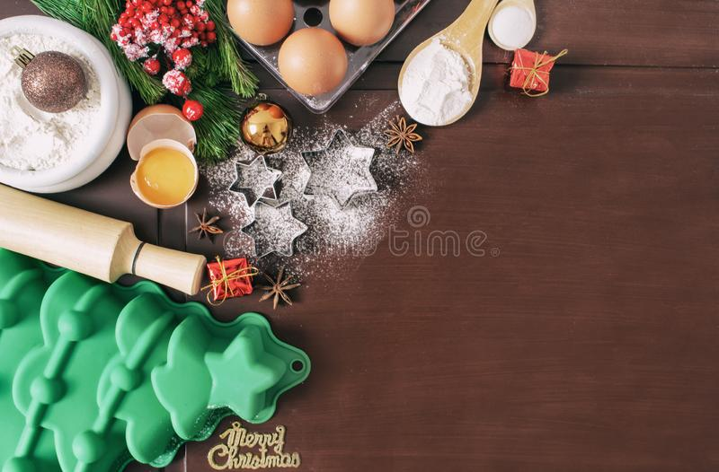 Christmas baking cake background. Ingredients and tools for baking - flour, eggs, silicone molds in the shape of a Christmas tree, stock images