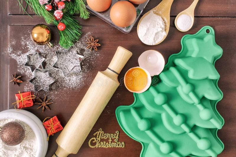 Christmas baking cake background. Ingredients and tools for baking - flour, eggs, silicone molds in the shape of a Christmas tree, stock photos