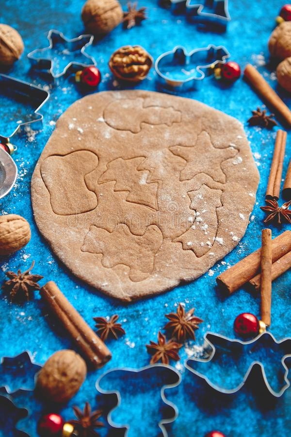 Christmas baking concept. Gingerbread dough with different cutter shapes stock photo