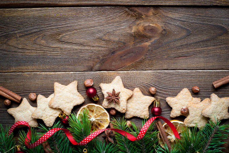 Christmas baking concept. Some cookies, fir tree brunches and decorations. Top view, copy space royalty free stock images