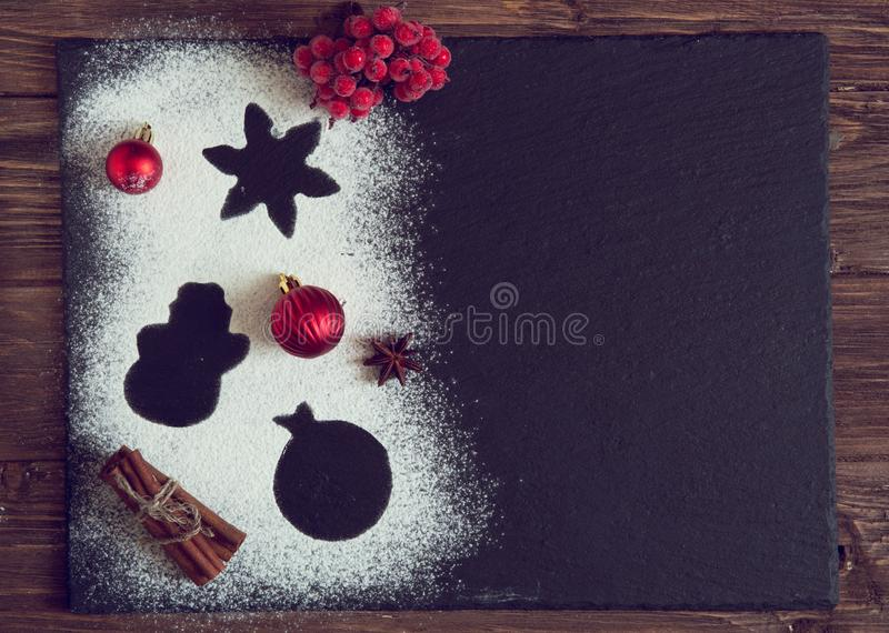 Christmas Baking dark slate background. Ingredients for cooking christmas baking on dark rusty background royalty free stock photo