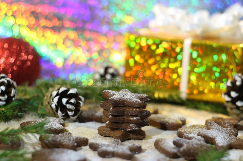 Christmas baking, ginger biscuits in powdered sugar stock photography