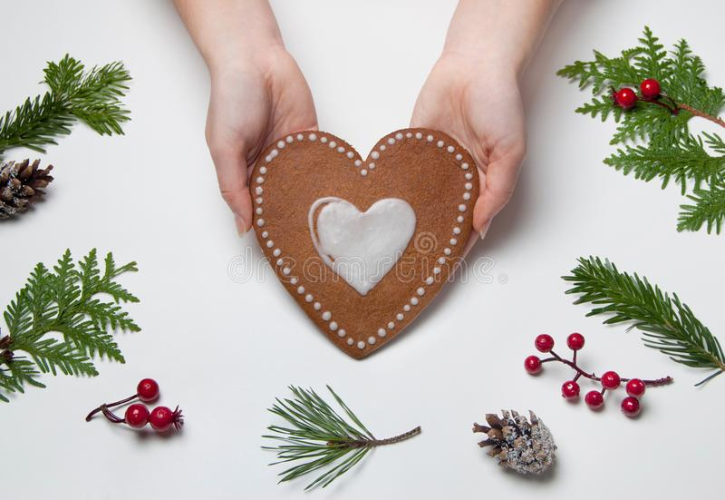 Christmas baking. Making heart shaped christmas gingerbread cookies. stock image