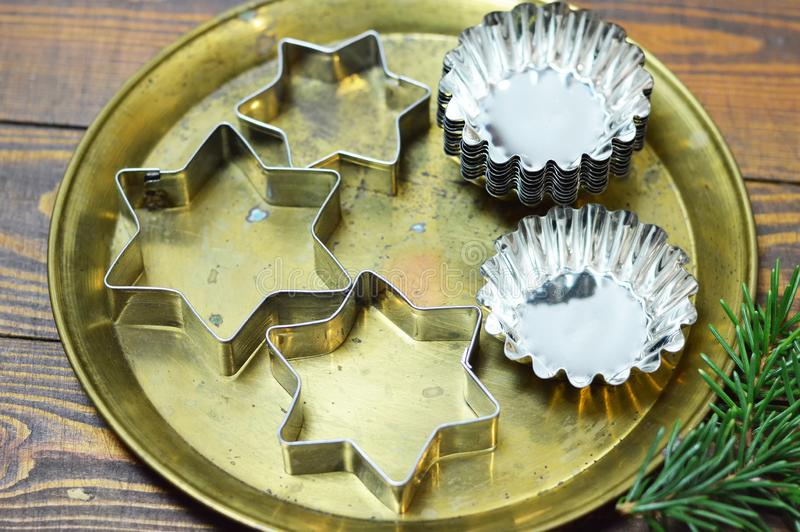 Christmas baking utensils. Christmas cookie cutters and molds stock images