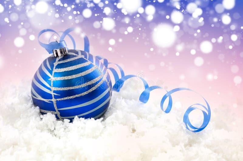 Christmas ball. Blue christmas ball in the snow stock photography