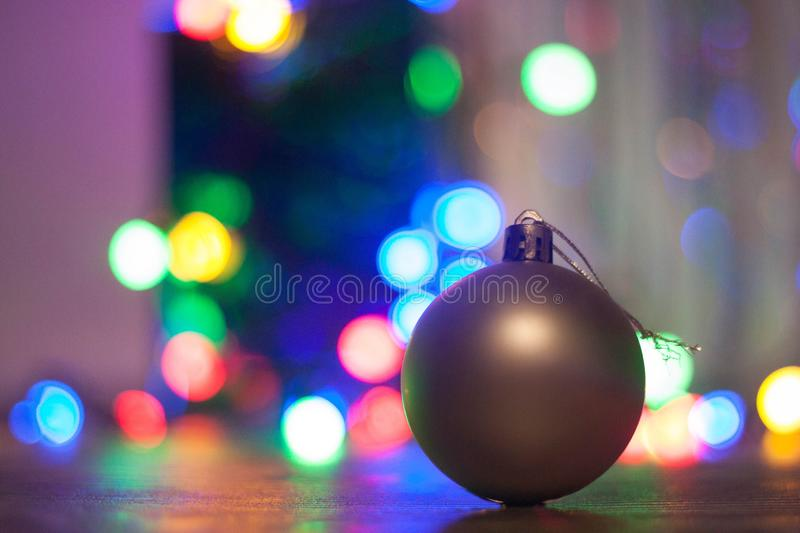 Christmas ball on bokeh background stock images