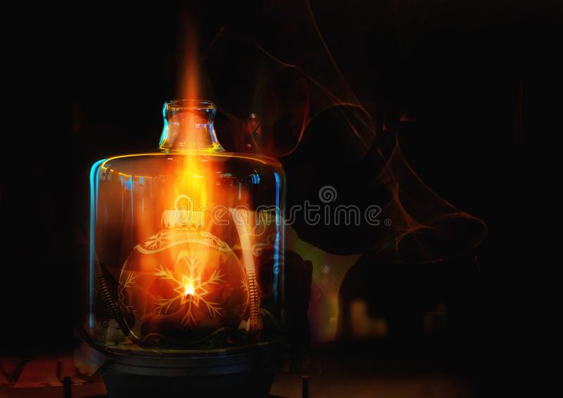 Christmas ball in a bottle with a magic fire stock photos