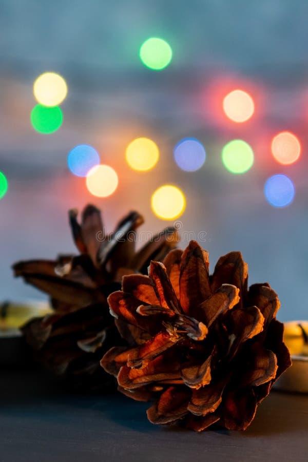 Christmas ball and burning candles. royalty free stock photo