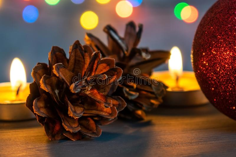 Christmas ball and burning candles. royalty free stock images