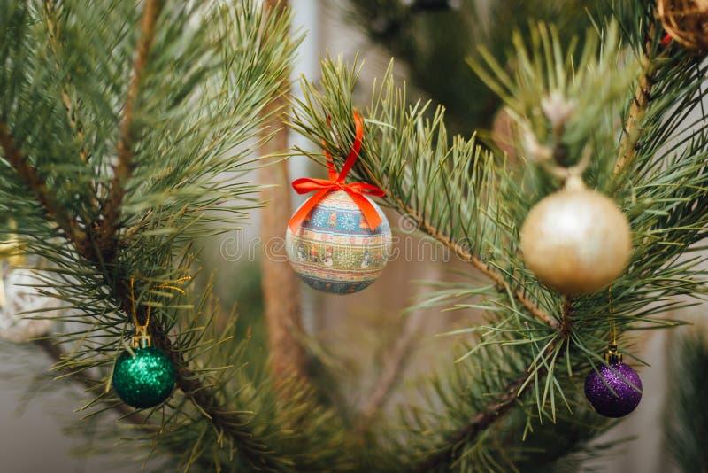 Christmas ball hanging on Christmas tree. Christmas ball, decorated with little snowmans, hanging on Christmas tree stock image