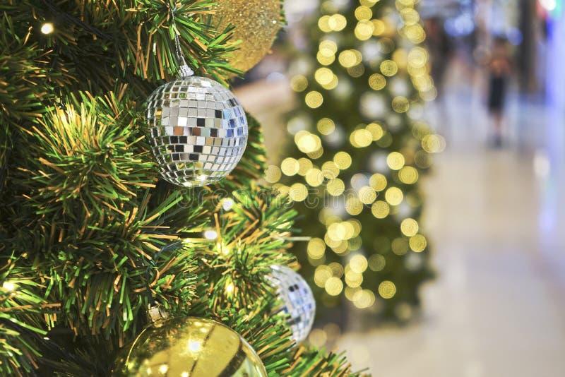 Christmas ball and decoration on pine tree. Christmas ball and decoration on pine tree and wonderful bokeh of lights royalty free stock photos