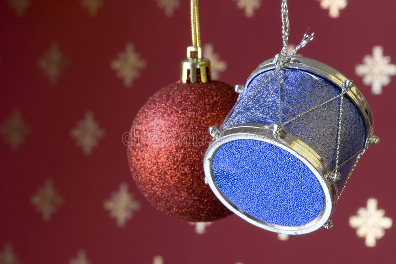 Christmas ball and drum. Pending with a snow effect background (selective and soft focus stock images