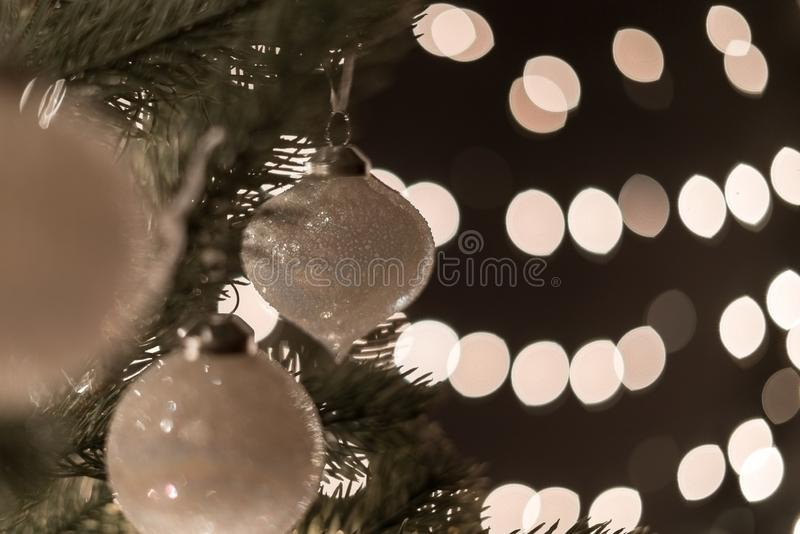 Christmas ball on fir tree with bokeh lights background with copyspace stock image