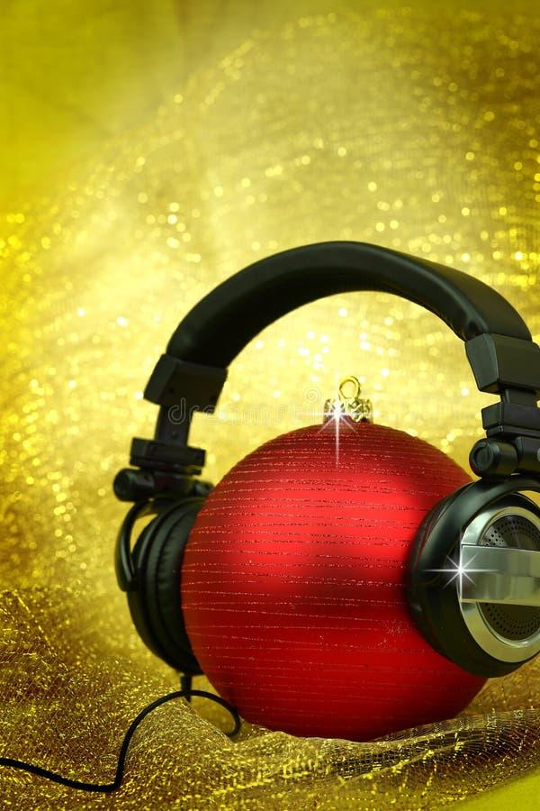 Christmas ball with headphones royalty free stock photo