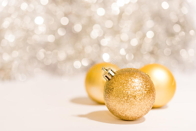 Christmas ball ornament decoration over golden background royalty free stock images