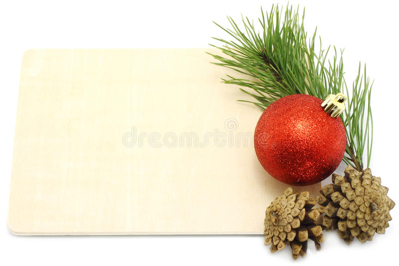 Christmas ball with pinecone and fir tree on a wod