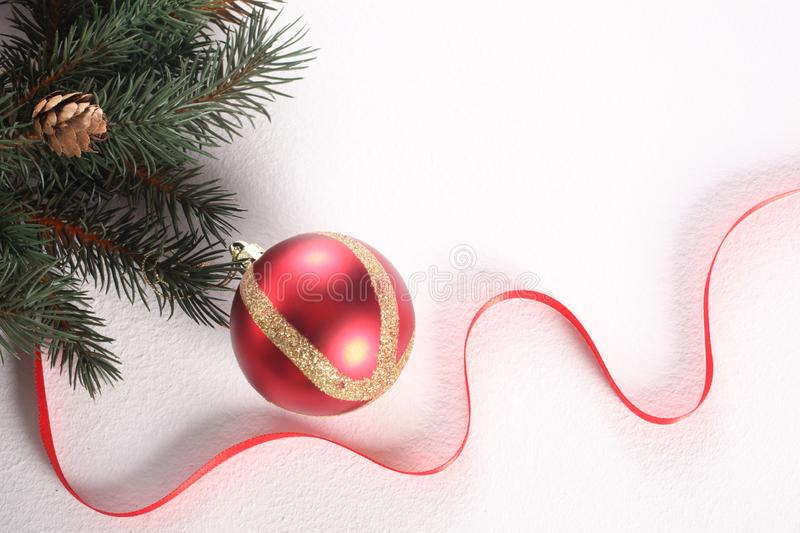 christmas ball, red ribbon and ornaments isolated on white background with copy space royalty free stock photos