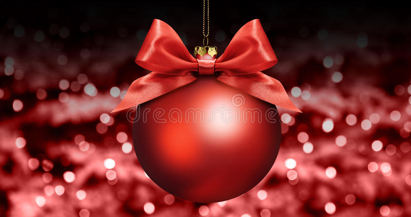 Christmas ball with red satin ribbon bow on red blurred lights b stock photo