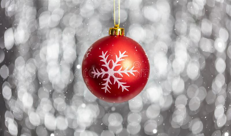 Christmas ball and snow in the night, abstract bokeh lights background,. Copy space royalty free stock image