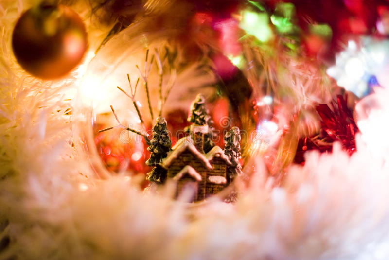 Christmas ball. A transparent beautiful Christmas ball with small house inside royalty free stock image