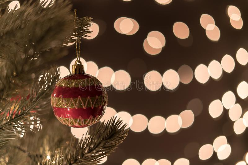Christmas ball on tree on bokeh lights background with copyspace royalty free stock images