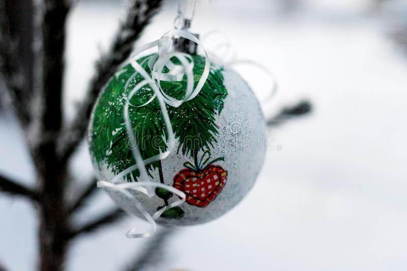 Christmas ball on the tree branches royalty free stock images