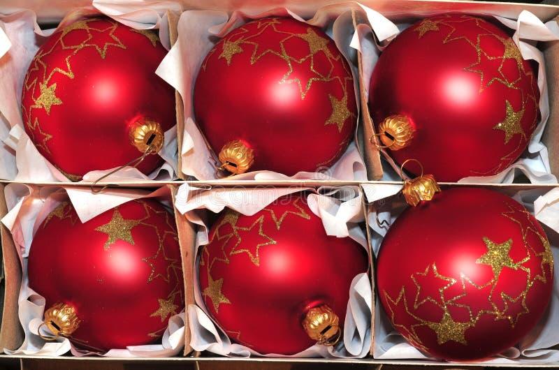 Christmas balls. Red christmas balls in a box royalty free stock photos