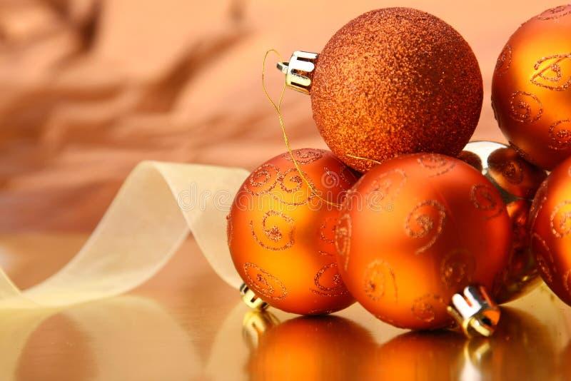 Christmas balls. Golden christmas balls with ribbon stock image