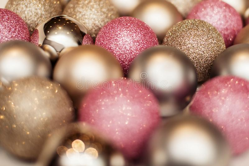Christmas balls background, happy new year. Christmas balls background pink and gold, happy new year royalty free stock photography